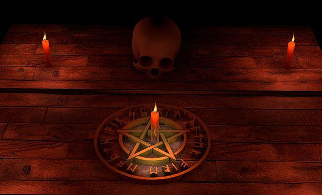 ритуал с черепом и свечами