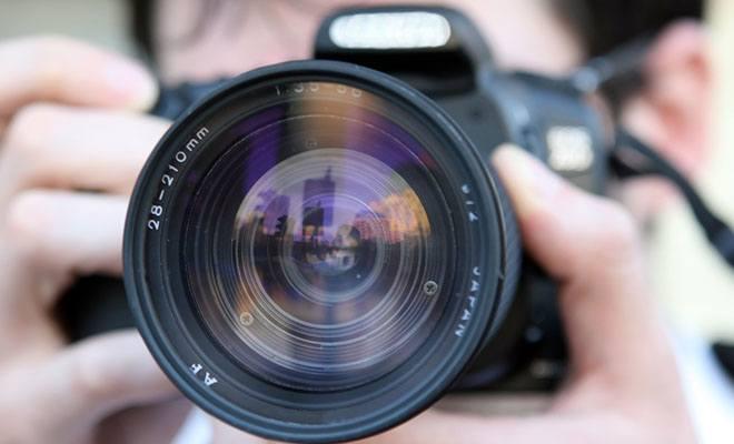 человек с фотокамерой